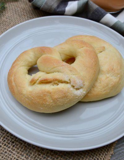 Finished Martinsbrezeln sweet pretzels on a grey plate