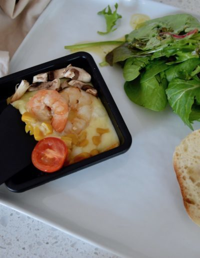 Cooked Raclette with Bread and Salad