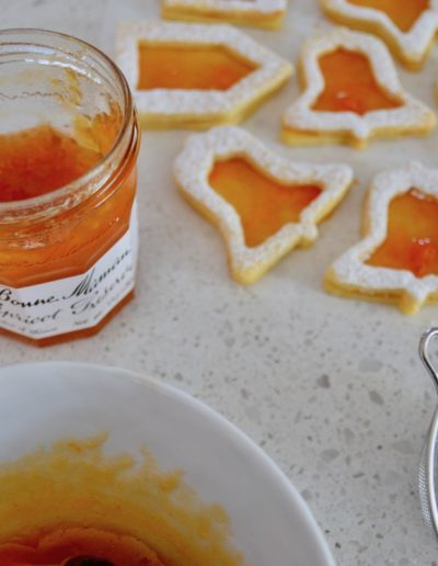 Spitzbuben getting filled with apricot jam