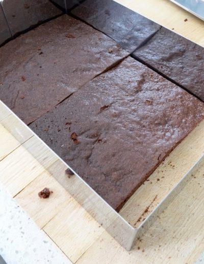 Arranging Milchschnitte in baking frame