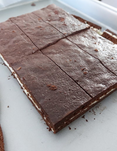After cooling, the Milchschnitte is ready to be trimmed and cut up!